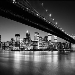Manhattan Skyline Wall Mural - A snazzy black and white mural depicting NYC at night. The dramatic play of light on the water and the twinkling lights of the city give this mural a glamorous classy air.