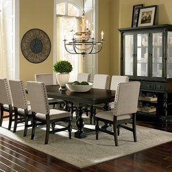 Juliette Dining Room Collection - Traditional Banquet. The beloved blend of cottage and traditional style are put on display in the Juliette collection. The pedestal table offers a glimpse into the regal past of early modern Europe, evoking a classic banquet hall. The antique black finish is beautifully contrasted by natural-hued, textured upholstery on the side chair. Large nailhead trim in aged bronze and elegantly turned legs provide just the right designer details. Seven piece package includes table and six side chairs, as shown.