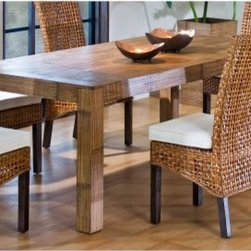 "Hospitality Rattan Pegasus Indoor Rattan & Wicker Rectangular Dining Table - Nat - It may seem simple, but your feelings for the Hospitality Rattan Pegasus Indoor Rattan & Wicker Rectangular Dining Table - Natural will be quite complex. You'll love the clean lines and the straightforward, natural appeal of the rattan body and crushed bamboo top. This table easily seats up to six people.About Hospitality Rattan Hospitality Rattan has been a leading manufacturer and distributor of contract quality rattan, wicker, and bamboo furnishings since 2000. The company's product lines have become dominant in the Casual Rattan, Wicker, and Outdoor Markets because of their quality construction, variety, and attractive design. Designed for buyers who appreciate upscale furniture with a tropical feel, Hospitality Rattan offers a range of indoor and outdoor collections featuring all-aluminum frames woven with Viro or Rehau synthetic wicker fiber that will not fade or crack when subjected to the elements. Hospitality Rattan furniture is manufactured to hospitality specifications and quality standards, which exceed the standards for residential use. Hospitality Rattan's Environmental Commitment Hospitality Rattan is continually looking for ways to limit their impact on the environment and is always trying to use the most environmentally friendly manufacturing techniques and materials possible. The company manufactures the highest quality furniture following sound and responsible environmental policies, with minimal impact on natural resources. Hospitality Rattan is also committed to achieving environmental best practices throughout its activity whenever this is practical and takes responsibility for the development and implementation of environmental best practices throughout all operations. Hospitality Rattan maintains a policy of continuous environmental improvement and therefore is a continuing work in progress. Hospitality Rattan's Environmentally Friendly Manufacturing Process All of Hospitality Rattan products are green. From its basic raw materials of rattan poles, peels, leather, bamboo, abaca, lampacanay, wood, leather strips, and boards, down to other materials like nails, staples, water-based adhesives, finishes, stains, glazes and packing materials, all have minimum impact to the environment and are safe, biodegradable, recycled, and mostly recyclable. Aside from this, the products have undergone an environmentally-friendly process that makes them """"greener."""" The company's rattan components are sourced from sustained-yield managed forests, which means the methods used to grow and harvest the rattan vines ensure the long-term life of the forest and protect the biodiversity of the forest's ecosystems. Hospitality Rattan is committed to buying and using all materials, from rattan and hardwood to finishing materials, from reputable and renewable suppliers and seeks appropriate evidence that suppliers are in compliance with this policy. Hospitality Rattan strives to use materials that are processed in an environmentally responsible manner, or consist of a high level of recycled material. Finishing materials and stains used in Hospitality Rattan's furniture products consist of 75% water-based solutions which evaporate upon application with reduced or Volatile Organic Compounds (VOCs). The furniture factories use water-based glues, stains, topcoats and other finishes on all of their products. The switch from traditional solvent-based processes to water-based processes involved consolidating several processes by the factories, resulting in an 85% reduction in VOC emissions."