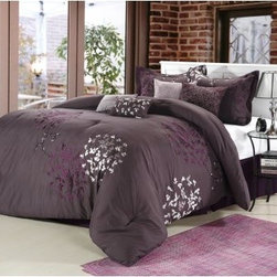 Chic Home Cheila Embroidered Comforter Set - A sumptuous bedroom essential, this Chic Home Cheila Embroidered Comforter Set is plush, plump, and filled with rich color. It has a background color of your choice with embroidered botanical print that's oh so modern and chic. This oversized and overfilled comforter set comes with everything you need to vamp up your master bedroom. The comforter features a soft polyester exterior with 100 GSM brushed microfiber fill. It's machine-washable in cold on the gentle cycle. Tumble dry on low and iron as needed. This set comes in your choice of color, size, and comes in either an 8- or 12-piece set.Bedding Set Components:8-piece Set: Comforter + Bedskirt + 2 pillow shams + 2 square 18 x 18-inch cushion + one 20 x 20-inch cushion + one 9 x 14-inch breakfast pillow 12-piece Set: Comforter + Bedskirt + 2 pillow shams + Sheet set: 1 flat sheet, 1 fitted sheet, 2 pillowcases + 2 square 18 x 18-inch cushions + one 20 x 20-inch cushion + one 9 x 14-inch breakfast pillowDimensions:Queen Comforter: 90 x 90 inchesQueen Bedskirt: 60 x 80(2) Queen Shams: 20 x 26King Comforter: 110 x 90 inchesKing Bedskirt: 78 x 80(2) King Shams: 20 x 36