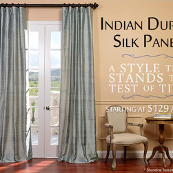 Indian Dupioni Silk Curtains - White as the petals of your favorite flower, Textured Dupioni Silk panels in Lily White will highlight any window in your home. Lily White is a vibrant white that will open up a room. The subtle texture and luster give the fabric a unique designer appearance.