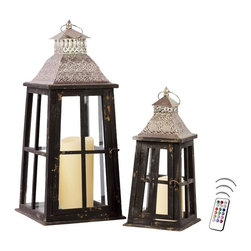 "Asian Import + USA - Beacon Lanterns with Flameless Candles and Remote Control - The Key West Lantern Collection is the perfect blend of traditional""and tropical designs with Caribbean influences.""These designer lanterns with a dark black finish are rich and elegant. The wood and glass design carries the visual romance of a watch tower. Sizes 15"" and 23"" high. Included are 4"" and 6"" Avion Select melted edge wax color candles with remote control timer. Note that candles pictured are for presentation only. The candles included in the set are described above. Set of 2"