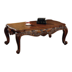 Coaster - Coaster Venice Traditional Rectangular Cocktail Table in Deep Brown Finish - Coaster - Coffee Tables - 700468 - This beautiful coffee table will help you complete your traditional living room decor. The smooth rectangular top has curved corners and bright radiant veneers in a rich brown finish. A shaped apron with an intricately carved shell and leaf design create a sophisticated look with elegantly curved scroll legs below. This cocktail table offers a nice place to set a book a beverage and decorative accent items. Add this table to your living room for a stunning centerpiece with warm traditional style. The Venice collection offers a simple solution for your traditional living room. Add these rich occasional tables for a quick style update. Beautifully shaped table tops intricately carved aprons with shell and leaf motif and elegant scroll legs create a sophisticated style. With the addition of your own accessories and decorative accent items your room will be transformed. The warm medium wood finish will complement almost any decor helping you create an inviting look in your living room.