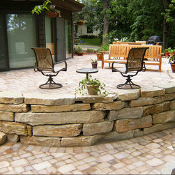 Natural Landscape Stone - Natural stone retaining wall and steps leading to additional walk out area.