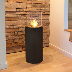 """Real Flame - Modesto Fireplace - Enhance any entry way with the Modesto Fireplace. A ventless, Clean-burning pillar ideal for patios, foyers, and outdoor entertaining. Features: -Comes complete with fire column, glass, burn cup and snuffer tool and decorative river rock.-Heat-resistant fiber-cast concrete and glass construction.-Distressed: No.-Powder Coated Finish: No.-Gloss Finish: No.-Fireplace Insert Only: No.-Freestanding Fireplace: Yes.-Wall Mounted Fireplace: No.-Tabletop Fireplace: No.-TV Stand Fireplace: No.-Fuel Type: Gel fuel.-Plug In: No.-BTU Output: 3,000 BTUs.-Number of Burners: 1.-Fuel Capacity: 13 Oz.-Burn Time of Fuel Accommodated: 2-3 Hours.-Adjustable Temperature: No.-Adjustable Flame: No.-Flickering Flame Effect: Yes.-Flame Operational Without Heat: No.-Thermal Overload Protection: No.-Safety Shut Off: No.-Air Filter: No.-Built In Fan: No.-Mantel: No.-Remote Control: No.-Batteries Included: No.-Timer Function: No.-Snuffer Included: Yes.-Indoor or Outdoor Use: Indoor and Outdoor Use.-Weight Capacity: 0 lbs.-Swatch Available: No.-Commercial Use: Yes.-Recycled Content: 0%.-Eco-Friendly: No.-Product Care: Cover when not in use.Specifications: -ISTA 3A Certified: No.-CSA Certified: No.-Carb 2 Certified: Yes.-TUV Certified: No.-KTL Certified: No.-ETL Certified: No.-CETL Certified: No.-UL Certified: No.-CUS Certified: No.Dimensions: -Overall Height - Top to Bottom (Finish: Black 38"""" H x 14"""" Diameter): 38"""".-Overall Width - Side to Side (Finish: Black 38"""" H x 14"""" Diameter): 14"""".-Overall Depth - Front to Back (Finish: Black 38"""" H x 14"""" Diameter): 14"""".-Overall Product Weight (Finish: Black 38"""" H x 14"""" Diameter): 36 lbs.Assembly: -Assembly Required: Yes.-Additional Parts Required: No.Warranty: -Product Warranty: 90 day warranty."""