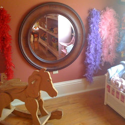 Sunny Project - NOLA Clutter Busters created a cute little girls space with wht the clients already owned. We hung the mirror low and put hooks in the wll for all her fun boa's ! Photo by: Tami HIlls