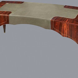 Skirt Desk by Antoine Schapira - Antoine's brass-inlaid skirt desk is a study in exquisitely considered and finished wood furniture. The richness, earthy redness of the Brazilian redwood is contrasted with the matted gray of the brass inlay and feet. A stunning centerpiece of any library, study or living room.