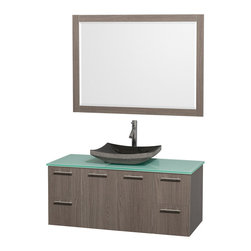 "Wyndham - Amare 48"" Wall Vanity Set in Grey Oak with Green Glass Top & Black Granite Sink - Modern clean lines and a truly elegant design aesthetic meet affordability in the Wyndham Collection Amare Vanity. Available with green glass or pure white man-made stone counters, and featuring soft close door hinges and drawer glides, you'll never hear a noisy door again! Meticulously finished with brushed Chrome hardware, the attention to detail on this elegant contemporary vanity is unrivalled.; Constructed of beautiful veneers over the highest grade MDF, engineered for durability, and to prevent warping and last a lifetime; 8-stage preparation, veneering and finishing process; Highly water-resistant low V.O.C. sealed finish; Unique and striking contemporary design; Modern Wall-Mount Design; Deep Doweled Drawers; Fully-extending soft-close drawer slides; Counter options include Green Glass, White Man-Made Stone, and Caesarstone (many colors available); Single-hole faucet mount; Available with Porcelain, Granite, and Marble vessel sink(s); Single-hole faucet mount; Faucet(s) not included; Mirror included; Metal exterior hardware with brushed chrome finish; Two (2) functional doors; Two (4) functional Drawers; Plenty of storage space; Includes drain assemblies and P-traps for easy assembly; Minimal assembly required; Weight: 262 lbs; Dimensions: Vanity: 48""W x 21-3/4""D x 20-1/4""H; Mirror(s): 49""L x 36""D x 3""H"