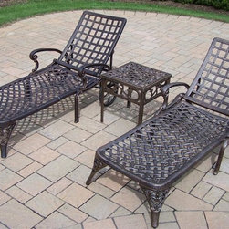 Oakland Living - 3-Pc Outdoor Chaise Lounge Set - Includes two chaise lounges and end table. Metal hardware. Lightweight. Fade, chip and crack resistant. Warranty: One year limited. Made from rust free cast aluminum. Antique bronze hardened powder coat finish. Minimal assembly required. End table: 17.5 in. W x 17.5 in. D x 19 in. H (15 lbs.). Chaise: 71 in. W x 25.5 in. D x 35 in. H (68 lbs.)This Chaise lounger set will be a beautiful addition to your patio, balcony or outdoor entertainment area. Our Chaise lounger sets are perfect for any small space, or to accent a larger space. We recommend that the products be covered to protect them when not in use. To preserve the beauty and finish of the metal products, we recommend applying an epoxy clear coat once a year. However, because of the nature of iron it will eventually rust when exposed to the elements. The Oakland Elite Collection combines old world charm and modern designs giving you a rich addition to any outdoor setting. The traditional lattice pattern is crisp and stylish. Each piece is hand cast and finished for the highest quality possible.