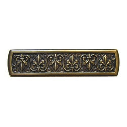 """Inviting Home - Fleur-de-Lis Pull (antique brass) - Hand-cast Fleur-de-Lis Pull in antique brass finish; 3-7/8""""W x 1""""H; Product Specification: Made in the USA. Fine-art foundry hand-pours and hand finished hardware knobs and pulls using Old World methods. Lifetime guaranteed against flaws in craftsmanship. Exceptional clarity of details and depth of relief. All knobs and pulls are hand cast from solid fine pewter or solid bronze. The term antique refers to special methods of treating metal so there is contrast between relief and recessed areas. Knobs and Pulls are lacquered to protect the finish. Alternate finishes are available. Detailed Description: The Fleur-de-lis means """"flower of the lily"""" It was used to represent French royalty. It was said that the king of France Clovis who started using the symbol of the Fleur-de-lis because the water lilies helped guide him to safety and aided him in winning a battle. The design in the Fleur-de-Lis pulls is arranged in alternating positions of the Fleur-de-lis. These pulls are a great match for the Fleur-de-lis knobs which have the Fleur-de-lis pattern arranged in a circle. The different shapes of decorative hardware make the cabinet doors and drawers interesting to look at."""