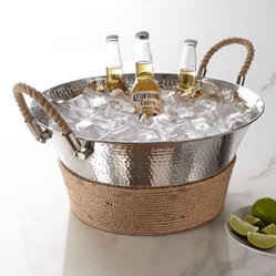 "Horchow - Adriatico Beverage Tub - A unique blend of sophistication and rusticity, this beverage tub accents hammered metal with rope trim for refined casual style. Made of hammered stainless steel and jute. Hand wash. 18""Dia. x 8.5""T. Imported."