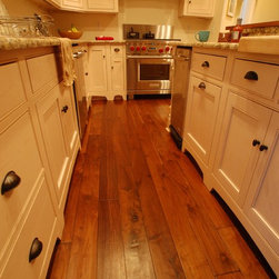French Country Walnut, Footworn Texture with French Bleed, Walnut Hull Tea Stain - A soft footworn texture adds depth and richness to a very regal walnut floor.