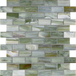 "Glass Tile Oasis - Dusk 1"" x 2"" Grey Pool Frosted Glass - Sheet size:  1.02 Sq. Ft.   Tile Size:  1"" x 2""   Tiles per sheet:  66    Tile thickness:  1/4""   Grout Joints:  1/8""   Recycled Components:  70%   Sheet Mount:  Paper Face     Sold by the sheet    - This collection is evocative of the glass-like natural layered silica created by volcanic stone formations. With a nod to old world Venetian glassmakers  our mosaics are created using the same processes from molten silica; hand-poured  blending transparent and opaque colors and natural and opalescent finishes into a unique  luxurious glass designed to please the most discriminating eye. It is available in 14 dramatic color blends and two finishes  Glossy & Frosted. Each piece is hand-poured and unique  designed with a certain amount of variation and variegation of color  tone  texture and shade for a distinctive appearance. Our hand-made process incorporates creases  wrinkles  waves  bubbles and other surface effects indicative of hand-made glass  all designed to capture light and enhance the final beauty of the project."