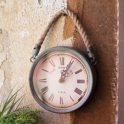 Metal Wall Clock with Rope - This antique-style wall clock brings a rustic element to your beach home. Edged in metal, with a durable rope to hang it from, we love it as  a sweet accent inside a family room or hallway.