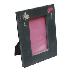 Sitara Collections - Hand-Engraved Lotus Palewa Soapstone Photo Frame - The Beauty and Purity of Lotus Flowers are Highlighted in this Hand-Carved Frame. Meticulously Crafted of Dark soapstome, It Surrounds Your Picture with Beautiful Depictioms of Blue, Pink and Celadom Lotus Flowers That add an Elegant Yet Whimsical touch to any Space.