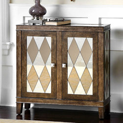 Trivelin Console Cabinet - Traditional form meets jaunty style in the Trivelin Console Cabinet. The woodenframe boasts a tarnished silver finish that lends the piece a soft, satiny luster. Insets featuring a harlequin pattern of clear and bronze mirrors beautify the front cabinet doors, the sides, and the top, adding a distinctive graphic detail that contrasts handsomely with the rich wood color of the chest
