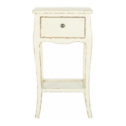 One Drawer Distressed End Table in Cream - Brighten any room with the curvaceous lines and traditional charm of the Safavieh Thelma end table. Crafted of poplar wood with distressed vanilla finish, this single drawer table with lower shelf is the perfect accent to country or coastal interiors.  Use the Thelma end table alone beside a chair, or in pairs on either end of a sofa or bed.