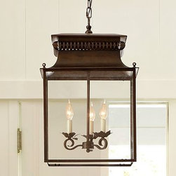 "Bolton Oversized Lantern, Bronze finish - With glass on four sides and a sloping roof, this lantern resembles an antique street lamp with its distressed bronze finish. Three lights are suspended inside, with their tendril-shaped arms ending in flower bobeches. 15"" square, 24"" high; 12' chain Framed in rust-resistant bronzed steel. Damp UL-listed. Hardwire; professional installation recommended. Catalog / Internet only."
