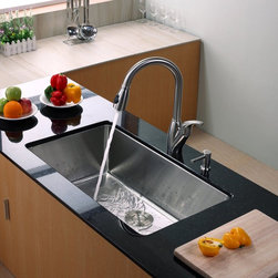 Kraus - Kraus KHU100-32-KPF2120-SD20 Single Basin Undermount Kitchen Sink with Faucet Mu - Shop for Kitchen from Hayneedle.com! You can be sure that your kitchen will be running smoothly with the Kraus KHU100-32-KPF2120-SD20 Single Basin Undermount Kitchen Sink with Faucet installing with ease. This innovative set features a multifunctioning faucet and an integrated soap dispenser for your convenience. It's made from stainless steel to take on corrosion without batting an eye.Product SpecificationsBowl Depth (inches): 10Weight (pounds): 34Low Lead Compliant: YesEco Friendly: YesMade in the USA: YesHandle Style: LeverValve Type: Ceramic DiscFlow Rate (GPM): 2.2Spout Height (inches): 8Spout Reach (inches): 10About KrausWhen you shop Kraus you'll find a unique selection of designer pieces including vessel sinks and faucet combinations. Kraus incorporates its distinguished style with superior functionality and affordability while maintaining highest standards of quality in its vast product line. The designers at Kraus are continuously researching and exploring broader markets seeking new trends and styles. Additionally durability and reliability are vital components at Kraus for developing high-quality fixtures. Every model undergoes rigorous testing and inspection prior to distribution with customer satisfaction in mind. Step into the Kraus world of plumbing perfection. With supreme quality and unique designs you will reinvent how you see your bathroom decor. Let your imagination become reality!