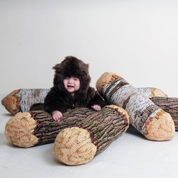 Long Cotton Wood Tree Log Bolster Pillow by Chic Sin Design - I've been craving one of these pillows for years; the faux log look is hilarious. They also have a really sweet faux bear-print oversize pillow.