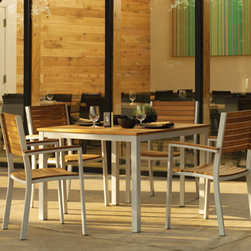 Travira Teak & Aluminum Outdoor Modern Dining Set - Lovely Modern Teak and Aluminum combination collection from Oxford Gardens.  Use this set at home or in a restaurant setting for a sleek look.