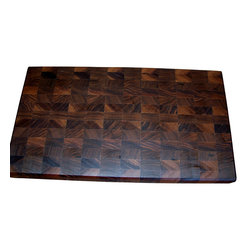 Lone Star Artisans - End-Grain Walnut Cutting Board - This End Grain Walnut Cutting Board is a beauty! Great for large jobs like carving meat or pulling meat off the grill. It can, of course, be used for just about any chopping job! The grain pattern in this board is complex and gorgeous. There are variations from light to dark throughout the board. End Grain Walnut is easy on a chef's knife, too. All of our wood comes from a sustainable forest in northern Pennsylvania.  Weight: 9lbs.