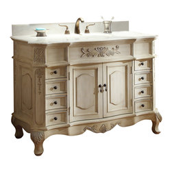 "Benton Collection - Traditional Style Morton Bathroom sink vanity 48"" - The antique white Morton bathroom vanity has classic traditional style. With carved decorative scrolling leaf design and carved turned legs, white marble top is a wonderful accompaniment to the finish and the hardware are real eye catcher adding the perfect touch. It is a truly amazing vanity. This lovely traditional vanity is the perfect addition to any bathroom decor. Showcase your bath with a vanity that speaks to your exquisite style."