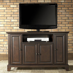 "Crosley - Newport 48"" TV Stand - Enhance your living space with one of Crosley's impeccably-crafted TV stands. This signature cabinet accommodates most 52'' flat panel TVs and is handsomely proportioned featuring character-rich details sure to impress. Raised panel doors strategically conceal stacks of CDs/DVDs, gaming components and various media paraphernalia. Open storage area generously houses media players and the like. Adjustable shelving offers an abundance of versatility to effortlessly organize by design, while cord management systems tame the unsightly mess of tangled wires. Customize our distinct cabinets by selecting one of four collection styles (featuring tapered, traditional. turned or bun feet) in your choice of one of three signature Crosley finishes. This customizable cabinet approach is designed for easy assembly, built to ship and constructed to last. Features: -Raised panel doors.-Five adjustable shelves for storing electronic components, gaming consoles, DVDs and other items.-Adjustable levelers in legs.-Recommended TV Type: Flat screen.-TV Size Accommodated: 48"".-Powder Coated Finish: No.-Gloss Finish: No.-Material: Hardwood and veneers.-Solid Wood Construction: No.-Distressed: No.-Exterior Shelves: Yes -Number of Exterior Shelves: 1.-Adjustable Exterior Shelves: No..-Drawers: No .-Cabinets: Yes -Number of Cabinets: 3.-Number of Doors: 4.-Door Attachment Detail: Pin hinge.-Interchangeable Panels: No.-Magnetic Door Catches: Yes.-Cabinet Handle Design: Knob.-Number of Interior Shelves: 5.-Adjustable Interior Shelves: Yes..-Scratch Resistant : No.-Removable Back Panel: No.-Hardware Finish (Finish: Black): Brushed nickel knobs, steel hardware.-Hardware Finish (Finish: Classic Cherry, Vintage Mahogany): Antique brass knobs, steel hardware.-Casters: No .-Accommodates Fireplace: No.-Fireplace Included: No .-Lighted: No .-Media Player Storage: Yes.-Media Storage: No .-Cable Management: Hole in back for wires.-Remote Control Included: No.-Batteries Required: No .-Weight Capacity: 200 lbs.-Swatch Available: No.-Commercial Use: No.-Collection: Alexandria.-Eco-Friendly: No.-Recycled Content: No .-Lift Mechanism: No.-Expandable: No.-TV Swivel Base: No.-Integrated Flat Screen Mount: No.-Hardware Material: Steel.-Product Care: Use a soft clean cloth that will not scratch the surface when dusting. Use of furniture polish is not necessary. Should you choose to use a furniture polish, test in an inconspicuous area first. Use os solvents of any kind could damage your furniture's finish. To clean, simply use a soft cloth moistened with lukewarm water, then buff with a dry soft clean cloth..Specifications: -ISTA 3A Certified: Yes.-FSC Certified: No.-General Conformity Certified: No.-CSA Certified: No.-EPP Certified: No.Dimensions: -Overall Height - Top to Bottom: 30"".-Overall Width - Side to Side: 47.75"".-Overall Depth - Front to Back: 18"".-Drawer: .-Shelving: Yes.-Cabinet: -Cabinet Interior Height - Top to Bottom: 23.5"".-Cabinet Interior Height - Top to Bottom: 16.5"".-Cabinet Interior Width - Side to Side: 9.75"".-Cabinet Interior Width - Side to Side: 23.5"".-Cabinet Depth - Front to Back: 14.75""..-Legs: Yes.-Overall Product Weight: 98 lbs.Assembly: -Assembly Required: Yes.-Tools Needed: Allen wrench (included) and screwdriver.-Additional Parts Required: No .Warranty:"