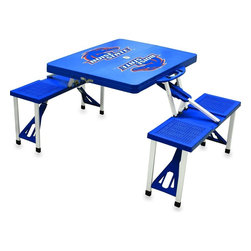 "Picnic Time - Boise State Picnic Table in Blue - Picnic Time's portable Picnic Table is a compact fold-out table with bench seats for four that you can take anywhere. The legs and seats fold into the table when collapsed so the item is easy to store and transport. It has a maximum weight capacity of 250 lbs. per seat and 20 lbs. for the table. The seats are molded polypropylene with a basket weave pattern in the same color as the ABS plastic table top. The frame is aluminum alloy for durability. The Picnic Table is ideal for outdoor or indoor use, whenever you need an extra table and seats. It includes a hole in the center of the table to accommodate a standard sized beach umbrella (having a pole that is 1.25"" diameter or less). Pair it up with Picnic Time's multi-colored stripe Umbrella (812-00-996) or solid colored Umbrella 5.5 (822-00) in red, green, blue or black, sold separately.; College Name: Boise State; Mascot: Broncos; Decoration: Digital Print"