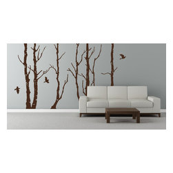 Cherry Walls - Forest Trees Mural - The silhouette of an enchanting winter woodland appears over the horizon — or is it just on your living room wall? Bring the enticing mystery of a January forest home with this dramatic wall decal. You can cuddle close in the warmth of your stylish room while the trees and birds prepare to wake up from a long winter's nap.