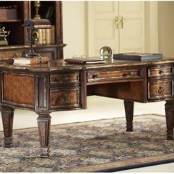 Hooker Furniture Beladora Writing Desk - Decorate your office in luxurious European style with the Hooker Furniture Beladora Writing Desk a richly colored desk featuring maple olive ash burl and walnut veneers with ornate scrollwork on the legs drawer fronts and desktop. This finely crafted furnishing is built from durable hardwood solids over engineered wood accented with a gold-tipped caramel finish and genuine leather writing surface. About Hooker Furniture CorporationFor 83 years Hooker Furniture Corporation has produced high-quality innovative home furnishings that seamlessly combine function and elegance. Today Hooker is one of the nation's premier manufacturers and importers of furniture and seeks to enrich the lives of customers with beautiful trouble-free home furnishings. The Martinsville Virginia based company specializes in lifestyle driven furnishings like entertainment centers home office furniture accent tables and chairs. Construction of Hooker FurnitureHooker Furniture chooses solid woods and select wood veneers over wood frames to construct their high-quality pieces. By using wood veneer pieces can be given a decorative look that can't be achieved with the use of solid wood alone. The veneers add beautiful accents of color and design to the pieces and are placed over engineered wood product for strength. All Hooker wood veneers are made from renewable resources and are located primarily on the flat surfaces of the furniture such as the case tops and sides. Each Hooker furniture piece is finished using up to 30 different steps including 13 steps of hand-sanding and accenting. Physical distressing is done by hand. Pieces receive two to three coats of solid lacquer to create extra depth and add durability to the finish. Each case frame is assembled using strong mortise-and-tenon joints which are then reinforced by mechanical fasteners and glue. On most designs end panels extend to the floor to add strength and stability. Panel-style furniture features