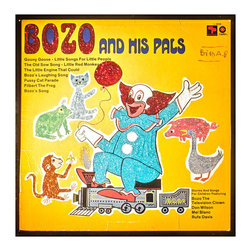 """Glittered Bozo Album - Glittered record album. Album is framed in a black 12x12"""" square frame with front and back cover and clips holding the record in place on the back. Album covers are original vintage covers."""