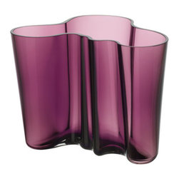 "iittala Aalto Vase 6 1/4"" Dark Lilac - A new color, never before seen on the Aalto vases comes to life in 2012. The Dark Lilac Aalto Vase has an understated charm as it blends effortlessly between lighter and darker hues of purple around each curve. Ideal for housing unique floral arrangements or sitting as a statement piece all on its own, this Dark Lilac Aalto Vase is a unique addition to any home décor."