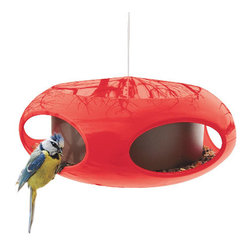 Astro Bird Feeder - This colorful, Jetsons-style, modern birdhouse would be the perfect addition to my mini porch makeover. The bright color will definitively attract all the little birdies in my backyard.