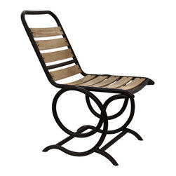 Volute Rocker - Innovative furnishings with attractive and timeless looks need not stop at your front door. The Volute Rocker is constructed from slats of aged wood set between outer bars of curved black metal, a traditional look for patio and sunroom furniture. Its shape, however, is something new: Each half of the frame makes a neat swirling spiral before joining the base, forming a double turn with a pleasantly curved outline and a transitional freshness.