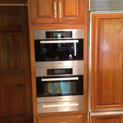 """Buck's Kitchen Renovation - The 24"""" wide Miele, Speed Oven, Speed Oven and Warming drawer replaced an old microwave/oven combination. Debbie Schaeffer"""