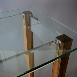 Black Limba Console Table with Acrylic and Glass - Black limba hallway table with acrylic rails and glass top. This detail shot shows how the wood and acrylic are held together with mortise and tenon and secured by stainless steel pins.