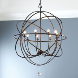 Orb Chandelier - This grand chandelier features an openwork sphere of hand wrought iron surrounding nine upright globe lights to illuminate your space. A single clear glass ball finial drops from the center for sparkling punctuation. Makes a grand statement in a large dining room, living room or entry.