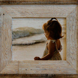 MyBarnwoodFrames - 18x24 Barnwood Picture FrameLighthouse Whitewash - One  of  our  newest  additions,  this  whitewashed  barnwood  picture  frame  combines  the  beautiful  design  of  our  3  Lighthouse  Series  frame,  but  with  a  touch  of  color.  We  add  a  wash  of  white  paint  to  the  frame  face,  giving  it  a  whitewashed  look.  Already  a  great  option  for  decor  that  needs  something  rustic  yet  neutral,  this  rustic  wood  frame  is  the  perfect  combination  of  color,  texture  and  style  all  wrapped  up  into  one  great  little  package.  This  style  works  well  with  several  different  decor  styles,  including  nautical,  western  and  country  decor.  One  of  our  most  popular  for  customers  looking  for  Cape  Cod  or  Western  Frames.  Please  keep  in  mind  that  due  to  the  nature  of  barnwood,  colors  and  textures  may  vary  slightly  from  what  you  see  pictured  here.          Product  Details:                  Rustic  wood  and  reclaimed  barnwood  picture  frame              Sawtooth  hanging  hardware  included              Cardboard  backing  included;  Glass  is  NOT  included              Handcrafted  in  USA              Hangs  horizontally  or  vertically              Picture  opening  fits  18x24,  finished  product  is  approximately  24x30