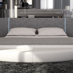 Rotondo Round Bed with LED Lights in Beige Eco-Leather - This modern round bed features LED Lighting conveniently placed on the headboard providing smooth ambiance. It includes two built- in nightstands for added convenience and usability.