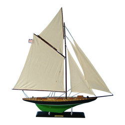 """Handcrafted Model Ships - Atlanta Limited 35"""" - Wooden Model Yacht -Wooden Sailing Boat - Not a model ship kit. Attach sails and the Atlanta model yacht is Ready for Immediate Display . This elegant model yacht of Canadian America's Cup challenger Atlanta is the perfect highlight for a bedroom or beach house, office or meeting room while sailing from atop any mantle, shelf or table. Brightening any room with her presence, Atlanta model sailboats shine with the unbound freedom of the wind, graceful speed of the waves and racing spirit of their famous namesake in this Limited Edition model yacht. 32"""" L x 4"""" W x 35"""" H (1:49 scale)."""