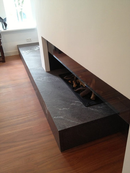 Modern Indoor Fireplaces by A Tre