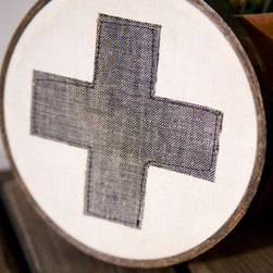 Classic Red Cross Wall Hanging in Hoop, Gray by Miniature Rhino - This gray Swiss cross wall hanging comes from one of my favorite Etsy shops, Miniature Rhino. It has a modern handmade style that would look great mixed in with frames on a gallery wall.
