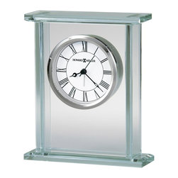 Howard Miller - Cooper Table Top Clock w Glass Panels and Rou - Glass and polished chrome alarm clock is the ideal bedside clock for your master bedroom or guest room. Its slim design means that it will not take up too much space on your night stand. The dial is suspended between glass panels and accented with a chrome bezel. Glass carriage alarm clock is constructed of 3/8 in. beveled glass panels. Dial offers a white background with black Roman numerals beneath glass and a polished chrome finished bezel. Both the hour and minute hands are black, while the seconds and alarm hands are silver. Quartz, alarm movement includes the battery. 5 3/4 in. W x 1 3/4 in. D x 7 in. H