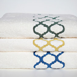 Product - Our Tangier, Moroccan inspired embroidery is shown on ivory Roma terry. Embroidery runs the width of the towel. Each towel set includes; Bath Towel (30x52) Hand Towel (18x32) Wash Cloth (13x13). Please specify if you want Meadow (Green, top) Foilage (Gold) or Pacific (Blue). Made in USA, photo credit to ANALI.
