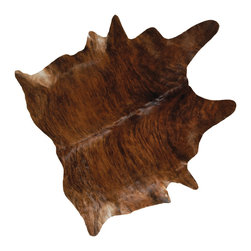 Kathy Kuo Home - Clark Brindle Brown Cowhide Rug - A uniquely patterned, hand-tanned cowhide rug adds a Rustic Lodge element to your home. Created as a rug, this artistic piece can be draped over an armchair or even hung on a wall. The rich brown pattern creates a warm welcome and a casual, cozy ambiance.