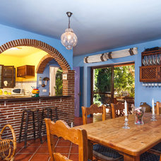 Mediterranean Dining Room by Goyo Photography