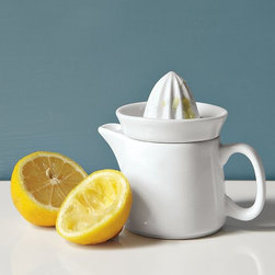 Mini Hand Juicer - Easy squeezy. Perfect for juicing citrus fruits of the smaller variety (say, lemons or limes), this stoneware set comes in two pieces. The removable top is perforated to keep pits form getting into the mix, while the handled and spouted bottom piece makes pouring easy. It can even do double-duty as a tea pot, making this piece especially great for adding lemon to hot tea.