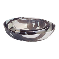 3-Piece Nesting Low Bowl Set - Nested together, this set of three low bowls looks like an abstract art piece. Laid out, you can see all their possible practical uses — for soup, salad or serving. These handmade bowls are authentically lovely.