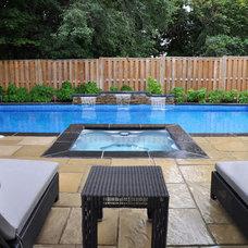 Contemporary Pool by Backyard Getaways Inc.